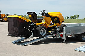 Southern Trailers - Brian James CarGo Flatbed Trailer being loaded with mower.