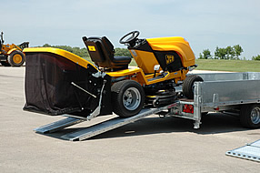 Southern Trailers - Flatbed being loaded with lawnmower