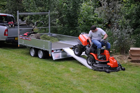 Southern Trailers - Plant Trailer being loaded with ride on mower.